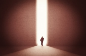 man walk toward the light